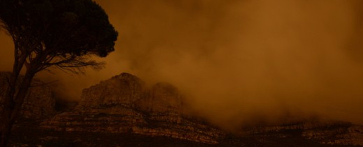 FILE: Table Mountain is plunged into darkness for the global Earth Hour intitiative, on 29 March, 2014. Picture: AFP.