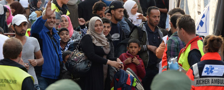 FILE: Incoming refugees wait for a medical check after their arrival in front of the main train station in Munich, Germany in September 2015. Picture: AFP.
