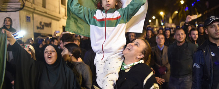 FILE: Algerians celebrate after Algeria's veteran President Abdelaziz Bouteflika informed the Constitutional Council that he is resigning in Algiers on 2 April 2019.