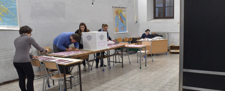 Polling station officers prepare ballots on the eve of a crucial referendum on constitutional reforms, on 3 December, 2016 in Rome. Picture: AFP.
