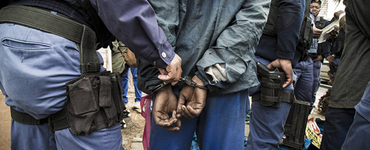 Saps officers arrest a man on the Grand Parade for selling illegal alchohol during an operation in Cape Town's CBD. Picture: Thomas Holder/EWN.