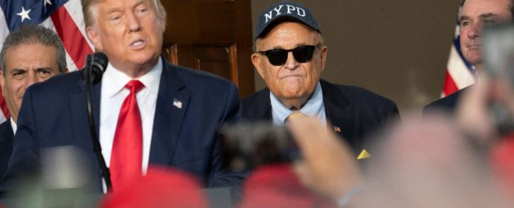 FILE: President Donald Trump's personal lawyer Rudy Giuliani listens as Trump delivers remarks to the City of New York Police Benevolent Association at the Trump National Golf Club in Bedminster, NJ, on 14 August 2020. Picture: JIM WATSON/AFP