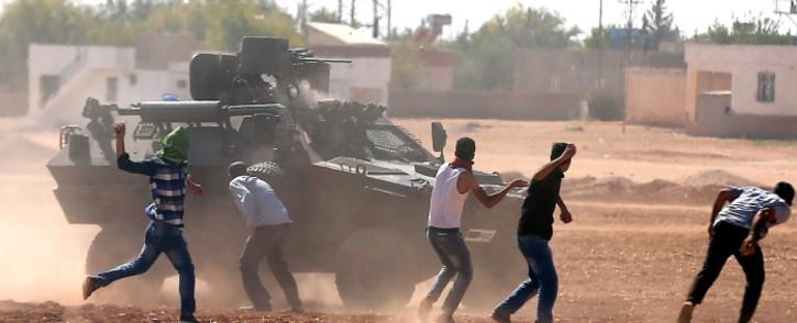 Turkish Gendarmerie clash with Kurdish demonstrators during a protest against Islamic State (IS) militants near Sanliurfa, Turkey, 07 October 2014. Picture: EPA/SEDAT SUNA.