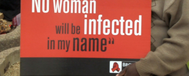 A poster held by one of the men attending the national men's rally against women and child abuse at the Johannesburg stadium on 24 August 2013. Picture: Reinart Toerien/EWN