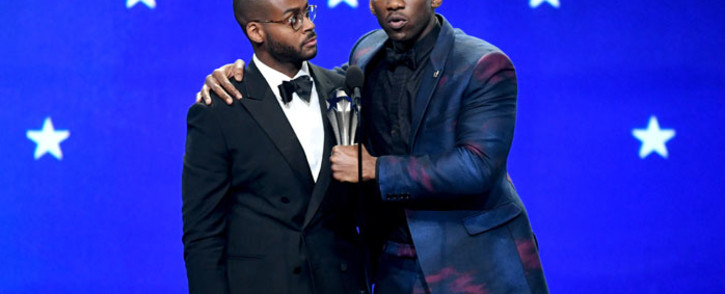 FILE: Kris Bowers (L) listens while winner Mahershala Ali accepts the Best Supporting Actor award for 'Green Book' onstage during the 24th annual Critics' Choice Awards at Barker Hangar on 13 January 2019. Picture: AFP