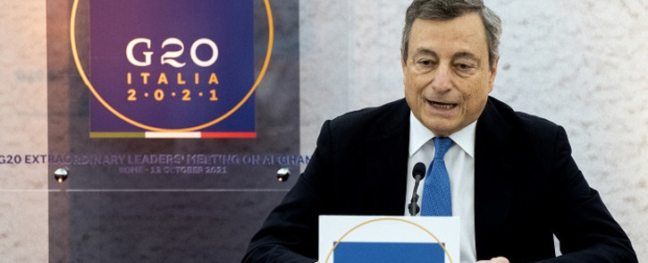 Italy's Prime Minister Mario Draghi speaks during a press conference following a G20 virtual summit focused on Afghanistan in Rome, on October 12, 2021. Picture: Tiziana Fabi / AFP.