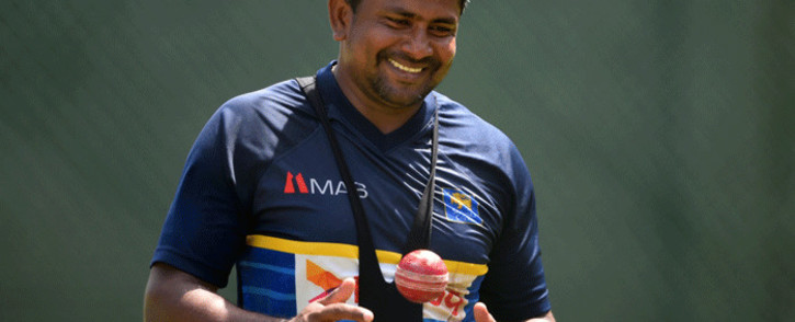 FILE: Sri Lankan cricketer Rangana Herath takes part in a training session at the Sinhalese Sports Club (SSC) cricket stadium in Colombo on 18 July 2018. Picture: AFP