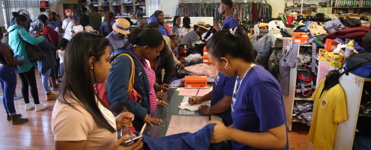 Parents get school uniforms for their children ahead of the start of the new Western Cape school year on 17 January, 2018. Picture: Bertram Malgas/EWN