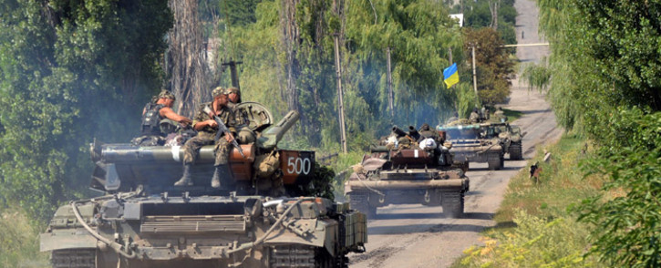 FILE: Ukrainian troops patrol near the village of Novoselovka, some 30 km from the eastern Ukrainian city of Donetsk, on 31 July, 2014. Picture: AFP.