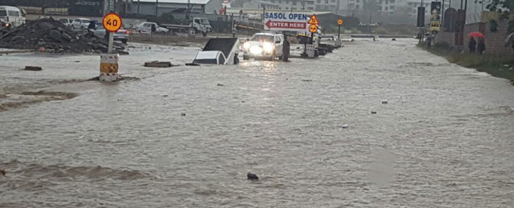 Booth Road in KwaZulu-Natal was flooded following heavy rain in the region. Picture: @SAPoliceService via Twitter.