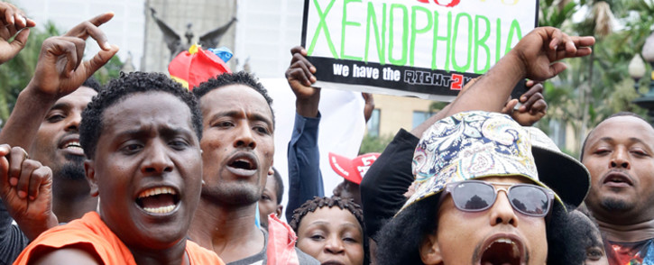 Demonstrators take part in an anti-xenophobic march outside the City Hall of Durban on 8 April, 2015. Hundreds of people marched today to protest against anti-immigrant violence, a week after hundreds were attacked near the eastern city of Durban. Picture: AFP.