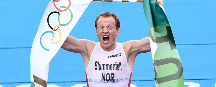 Norway's Kristian Blummenfelt celebrates finishing first to win gold in the men's individual triathlon competition during the Tokyo 2020 Olympic Games at the Odaiba Marine Park in Tokyo on 26 July 2021. Picture: Loic Venance/AFP