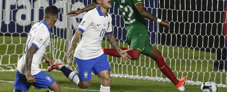 Brazil's Philippe Coutinho celebrates after scoring the second goal against Bolivia during their Copa America football tournament group match at the Cicero Pompeu de Toledo Stadium, also known as Morumbi, in Sao Paulo, Brazil, on 14 June, 2019. Picture: AFP.