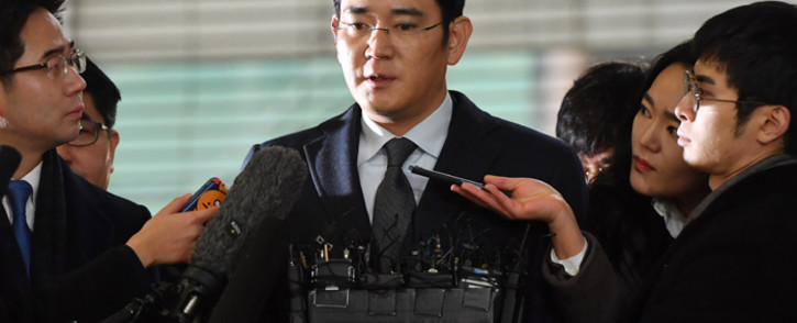 FILE: Lee Jae-Yong, vice chairman of Samsung Electronics, arrives to be questioned as a suspect in a corruption scandal that led to the impeachment of South Korea's President Park Geun-Hye, at the office of the independent counsel in Seoul on 13 February, 2017. Picture: AFP