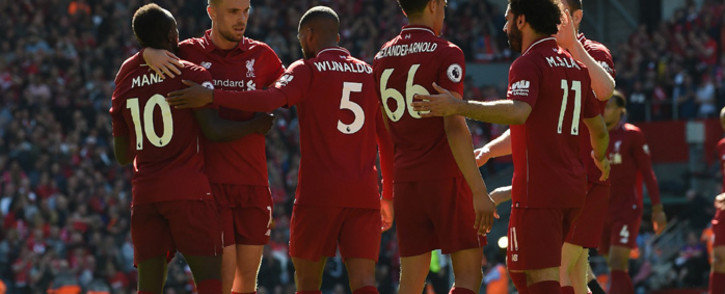 Liverpool players celebrate after beating Wolves in their Premier League match on Sunday. Picture: @LFC/Twitter.