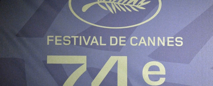 This photograph taken in Paris on June 3, 2021 shows the logo of the 74th Cannes Film Festival during a press conference, announcing the Official Selection of the 74th Cannes Film Festival to be held from July 6 until July 17, 2021. Picture: AFP.