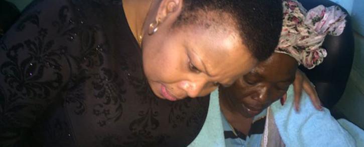 Deputy Police Minister Maggie Sotyu with Sinoxolo Mafevuka's mother Nowethu Mafevuka. Picture: Monique Mortlock/EWN.