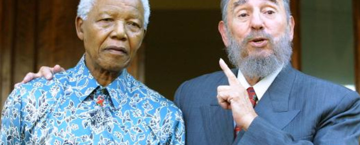 FILE: Former South African president Nelson Mandela with former Cuban Prime Minsiter Fidel Castro in Johannesburg on 2 September 2001 Picture: AFP.