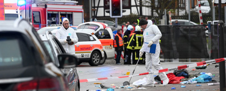 Forensic police officers are seen close to the site where a car drove into a carnival procession in Volkmarsen near Kassel, central Germany, on Rose Monday, 24 February 2020. Picture: AFP