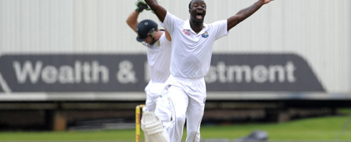 West Indies bowler Kemar Roach (R) unsuccessfully appeals for the wicket of South African batsman AB De Villiers(L) during the first day of the First test match between South Africa and the West Indies at the Supersport Park in Centurion on 17 December , 2014. Picture: AFP.