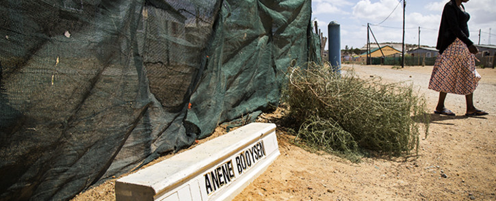 A Bredasdorp resident walks past a street dedicated to teenager Anene Booysen, who was murdered in the town in February 2013. Picture: Thomas Holder/EWN