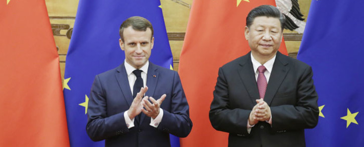 Chinese President Xi Jinping (right) and French President Emmanuel Macron (left) stand in front of Chinese and EU flags at a signing ceremony inside the Great Hall of the People in Beijing on 6 November 2019. Picture: AFP