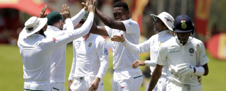 Lungi Ngidi (centre) celebrates a wicket with his Proteas teammates. Picture: AFP