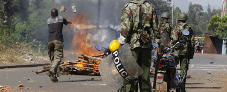 FILE: At least 15 people were killed by police enforcing a coronavirus curfew, IPOA said. Scores of other serious crimes were alleged, and social media littered with graphic scenes of police violently clearing the streets before nightfall. Picture: AFP