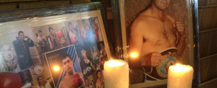 A shrine, in remembrance of boxing legend Corrie Sanders, at the entrance to the church where his funeral service was held. Picture: Barry Bateman/EWN.