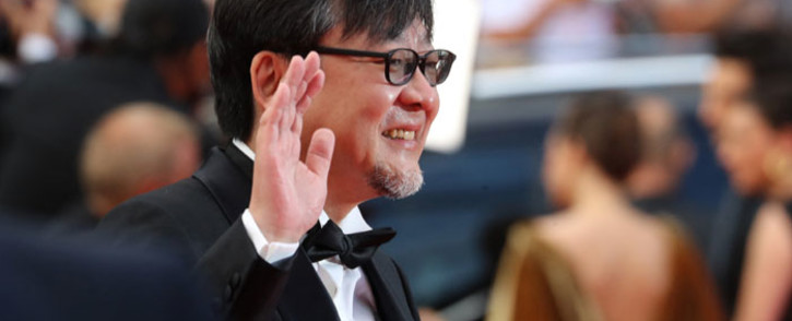 """Japanese animation director Mamoru Hosoda arrives for the screening of the film """"France"""" at the 74th edition of the Cannes Film Festival in Cannes, southern France, on 15 July 2021. Picture: Valery Hache/AFP"""