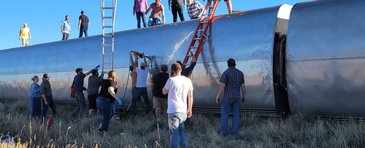 Approximately 141 passengers and 16 crew members were on board when eight train carriages came off the tracks in northern Montana. Picture: Twitter