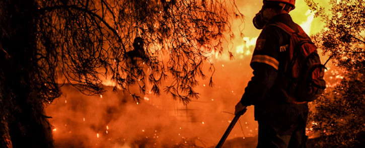 A firefighter is at work to extinguish a wildfire in Skinos, south of Athens, on May 19, 2021. Scores of Greek villagers were evacuated early on May 20, 2021 as a forest fire raged overnight around the protected wildlife habitat of Mount Geraneia, the fire department said, with no injuries immediately reported. Picture: Valerie Gache / AFP
