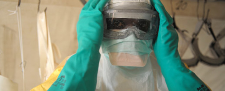 FILE: Health specialists prepare for work in an isolation ward for patients at the Doctors Without Borders facility in Gukedou, southern Guinea. Picture: AFP.
