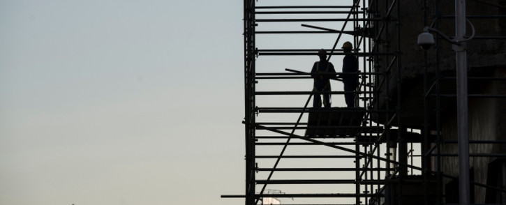 Construction workers on scaffolding at a Johannesburg construction site in May 2015. Picture: AFP.
