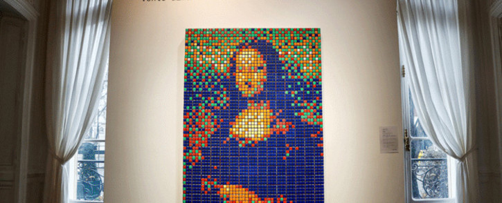 The street art Rubik's Cube version of the 'Mona Lisa' entitled 'Rubik Mona Lisa' made in 2005 by French artist Invader is on display at the Artcurial auction house in Paris on 3 February 2020. Picture: AFP.