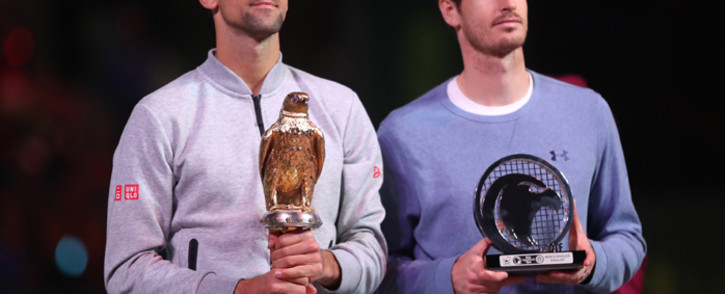 Serbia's Novak Djokovic poses with the winner's trophy after beating Britain's Andy Murray during their final tennis match at the ATP Qatar Open in Doha on 7 January, 2017. Picture: AFP.