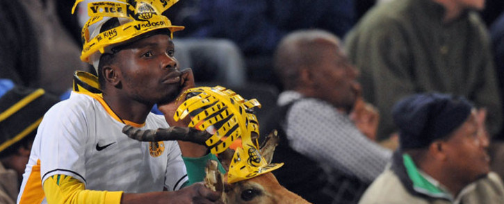 A Kaizer Chiefs' fan looks on next to his antelope during a friendly football match against Manchester City on July 21, 2009, in Durban. Manchester City won 1-0. Picture: AFP.