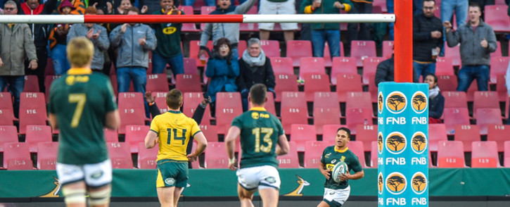 South Africas' Herschel Jantjies (R) scores his first try on debut with the Springboks during the 2019 Rugby Championship match, South Africa v Australia, at the Emirates Airline Park in Johannesburg, on 20 July 2019. Picture: AFP.