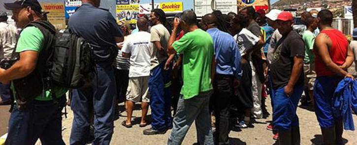 Fishermen protest outside the entrance to the Hout Bay Harbour. Picture: Siyabonga Sesant/EWN