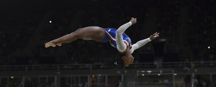 US gymnast Simone Biles competes in the beam event of the women's individual all-around final at the Olympic Arena during the Rio 2016 Olympic Games. Picture: AFP.