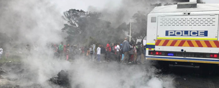 FILE: A group of Ocean View protesters are seen next to a police van during a demonstration against gang violence. Picture: Kevin Brandt/EWN