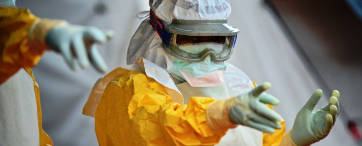 An MSF medical worker at an Ebola treatment facility. Picture: AFP.
