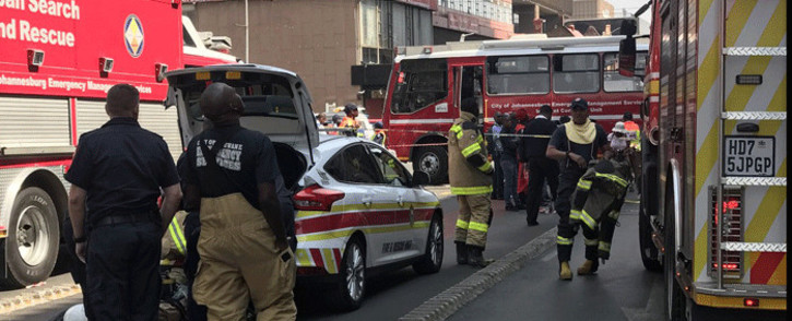 Fire trucks and firefighters from the City of Tshwane at the Johannesburg CBD to assist with fighting the blaze. Picture: Christa Eybers/EWN