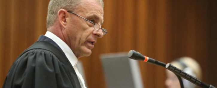 Gerrie Nel says it's unusual for Roger Dixon not to present the court with a report of his findings. Picture: Pool.