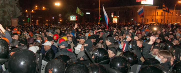 FILE: Pro-Russian protesters storm regional administration building in the eastern Ukrainian city of Kharkiv on 6 April, 2014. Picture: AFP.