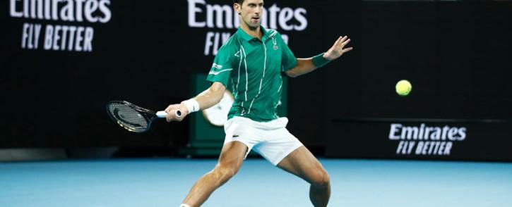 Novak Djokovic hits a return during his Australian Open match against Milos Raonic on 28 January 2020 in Melbourne, Australia. Picture: @AustralianOpen/Twitter