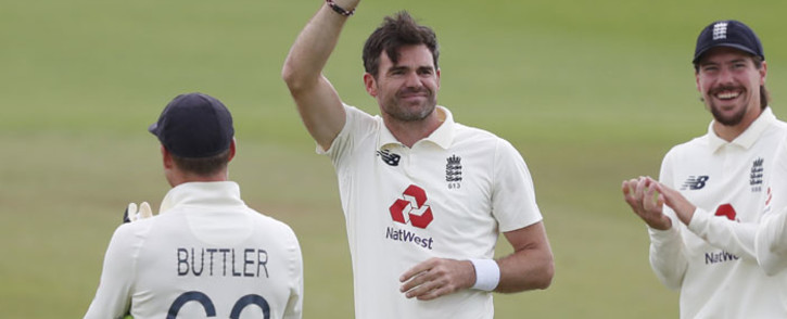 England's James Anderson (C) shows the ball as he is applauded by teammates after taking the wicket of Pakistan's Azhar Ali, his 600th test match wicket, on the fifth day of the third Test cricket match between England and Pakistan at the Ageas Bowl in Southampton, southern England on 25 August 2020. Picture: AFP