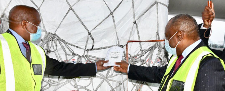 Deputy President David Mabuza and President Cyril Ramaphosa celebrate the arrival of the first million doses of the AstraZeneca COVID-19 vaccine at OR Tambo International Airport on 1 February 2021. Picture: GCIS.