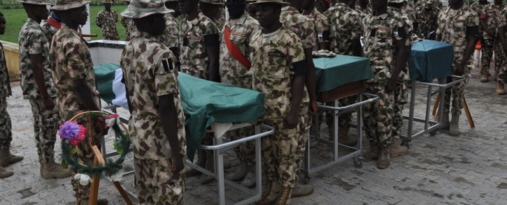 Nigerian soldiers stand on attention during the funeral on 26 September 2020 of the Nigerian soldiers killed in the attack on vehicles carrying Borno governor Babagana Umara Zulum near the town of Baga on the shores of Lake Chad. Picture: AFP