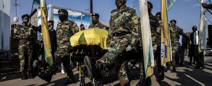 Members of the South African National Defence Force carry Andrew Mlangeni's coffin to his home in Dube, Soweto, on 28 July 2020. Picture: Kayleen Morgan/EWN.
